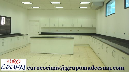 WHITE MELAMINE WITH TOP OF BLACK GRANITE