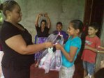 IN HONDURAS GIVING CLOTHING TO THE PEOPLE......