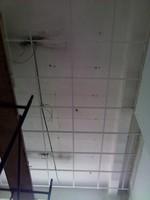 installatie van plafonds met tegel-systeem