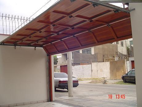 AUTOMATIC GARAGE DOORS WITH REMOTE CONTROL PERU DOOR